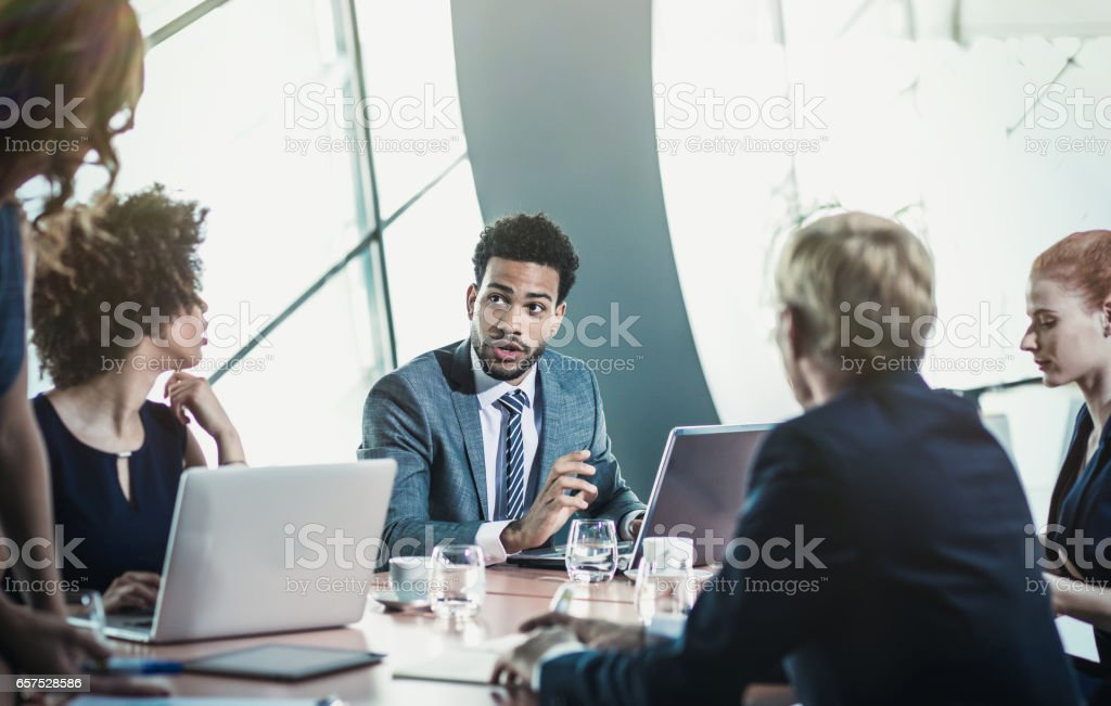 <<Small Group of Business People Having Meeting in the Board Room>>