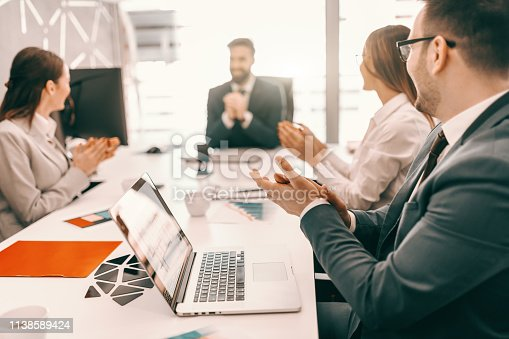 913332100 istock photo Small group of business people in formal wear sitting at boardroom and clapping to CEO. I am in the process of becoming the best version of myself. 1138589424