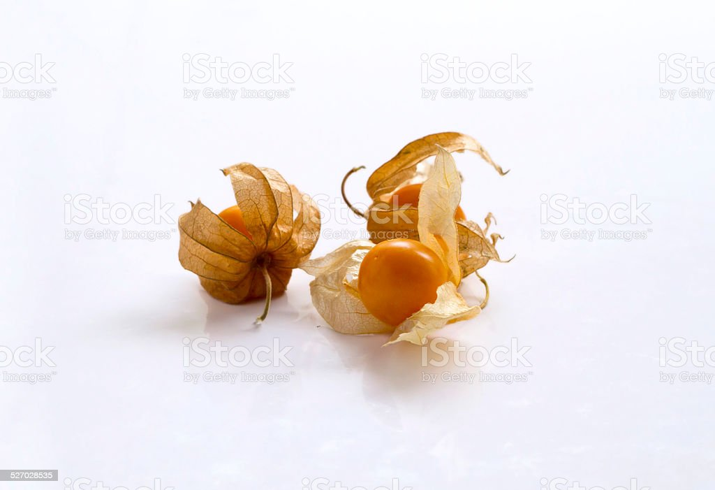 Small group of Cape Gooseberries isolated on white background stock photo