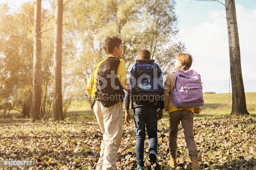 istock Small group of  children returning from school. 640099712