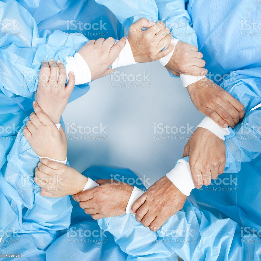 Small group of doctor team joining hands stock photo