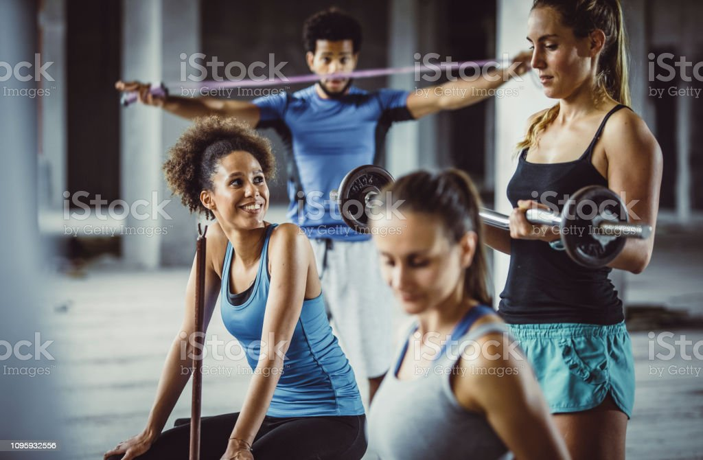 Small Group of Friends Exercising Together in a Gym