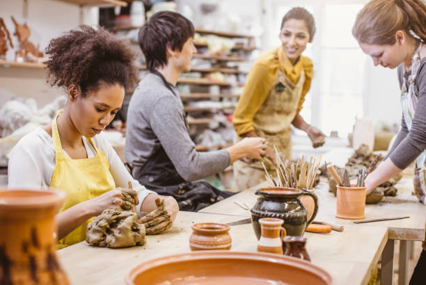 Small Group of People Doing Pottery in an Art Studio stock photo