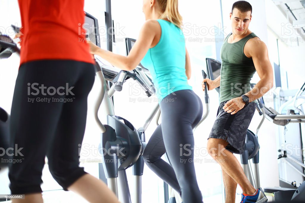 Small group of people exercising in gym. stock photo