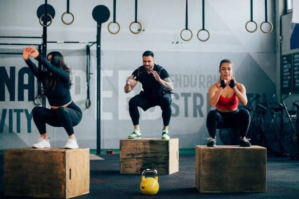 Small group of people working out in a gym stock photo
