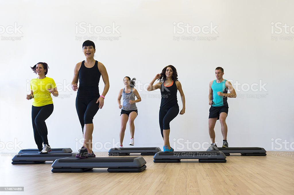 Small group of young people doing aerobics royalty-free stock photo
