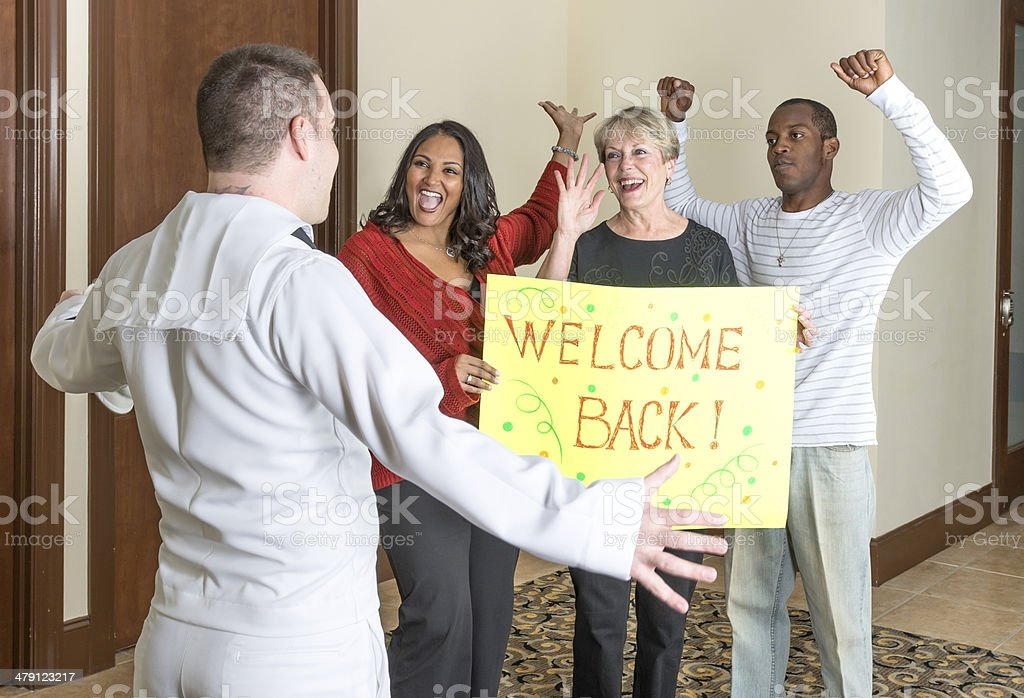 Small group welcoming home a sailor royalty-free stock photo