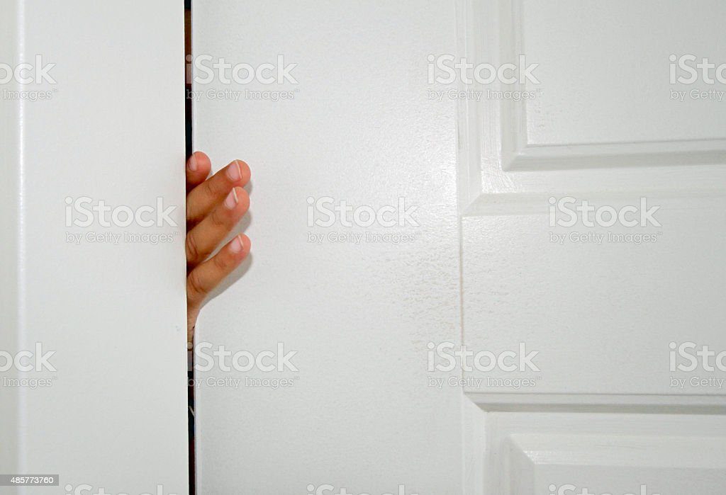 Small hand stuck in door stock photo