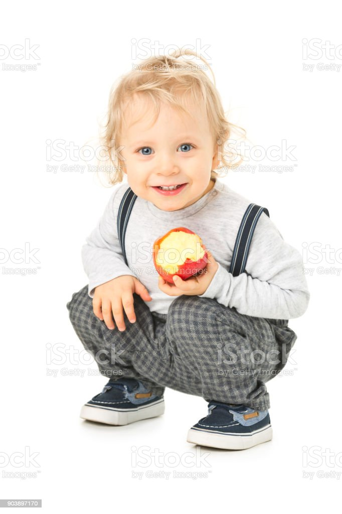 Small happy boy with apple stock photo