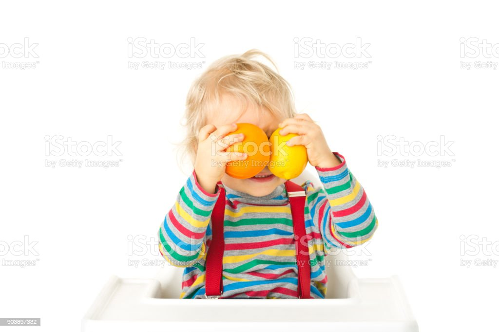 Small happy boy with fruits stock photo