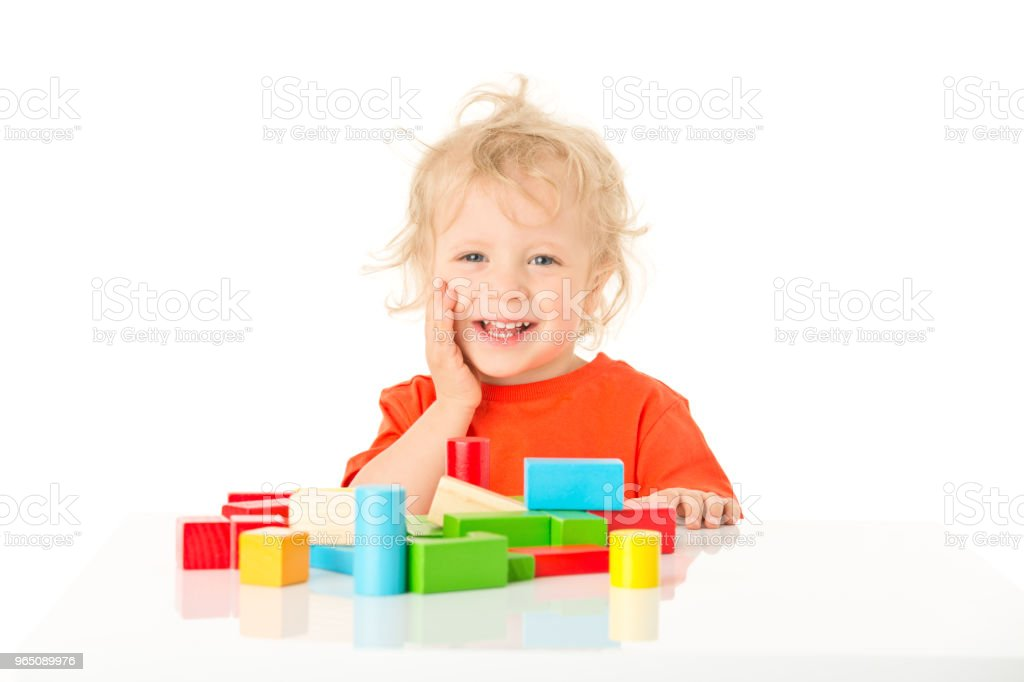 Small happy boy with wooden blocks royalty-free stock photo