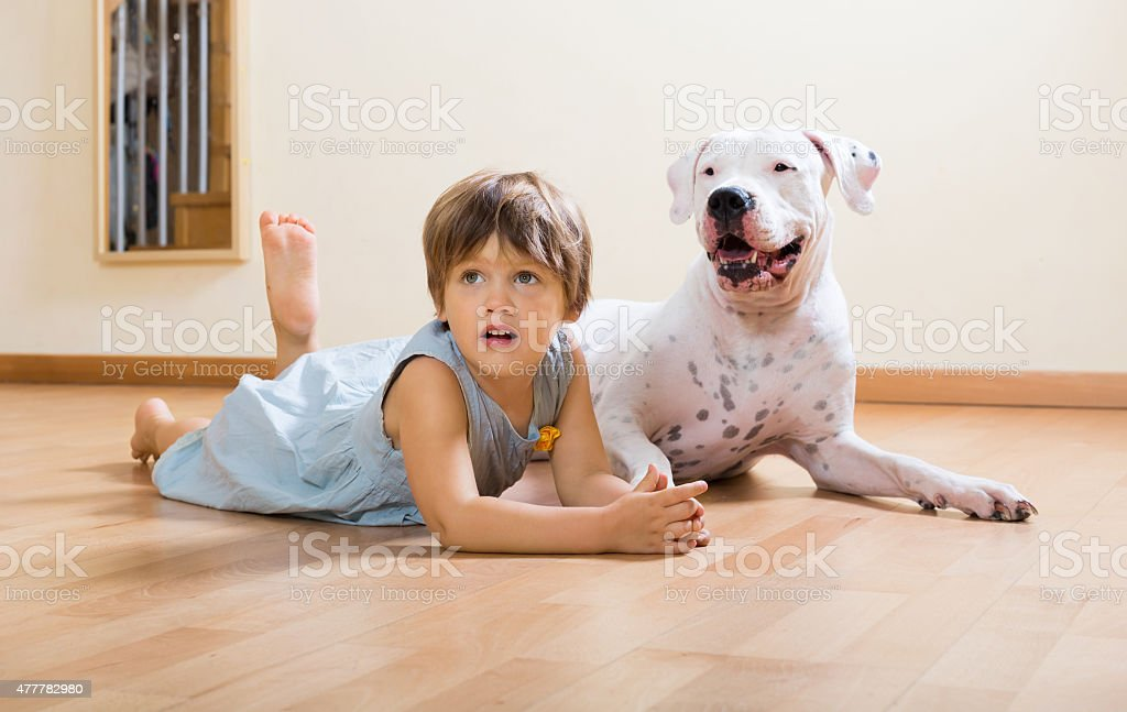 small happy girl on the floor with dog stock photo