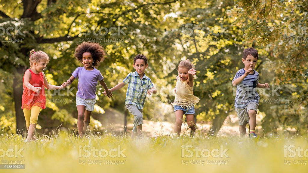 Small happy kids having fun while running in nature. – Foto
