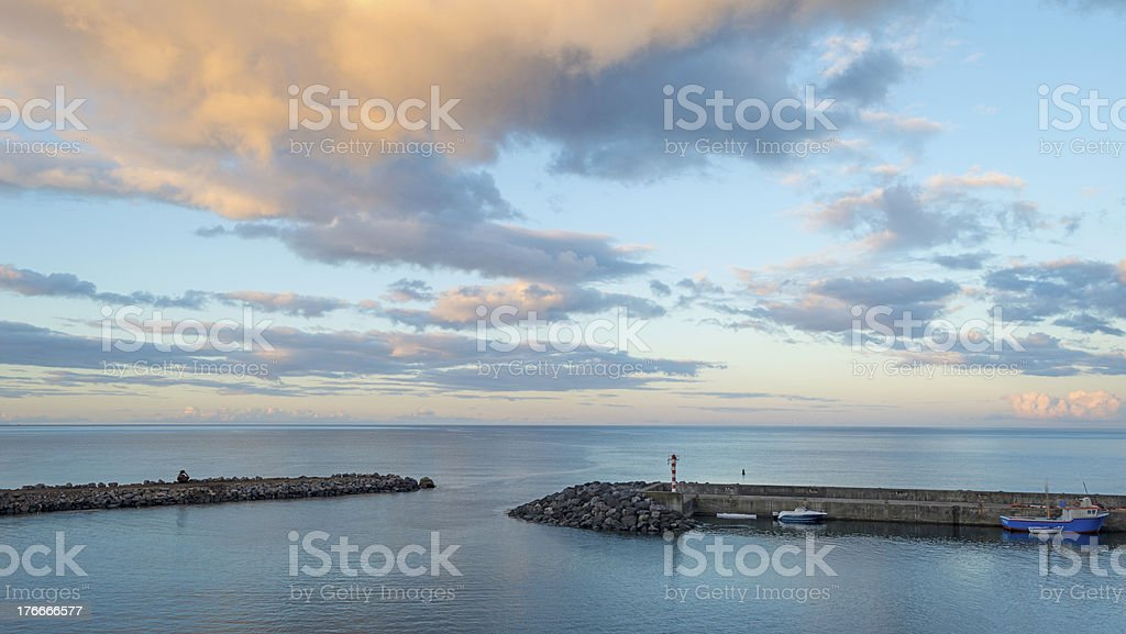 Small harbor at dawn in the Azores royalty-free stock photo