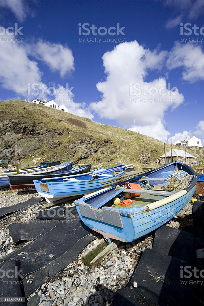 Small harbour with boats on beach stock photo