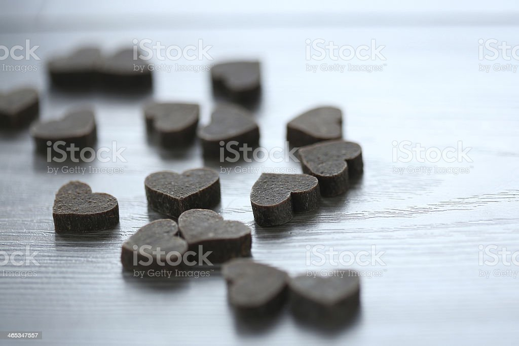 Small hearts on wooden background stock photo