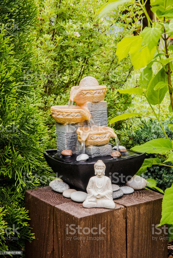 Small Home Garden Private Fountain With Meditating Buddha Statue Between Trees And Bushes Private Zen Garden Concept Stock Photo Download Image Now Istock