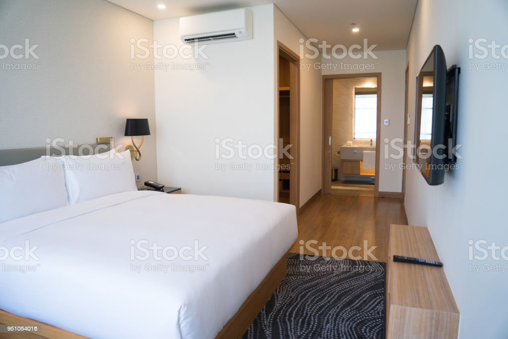 Small Hotel Room Interior With Double Bed And Bathroom Stock Photo
