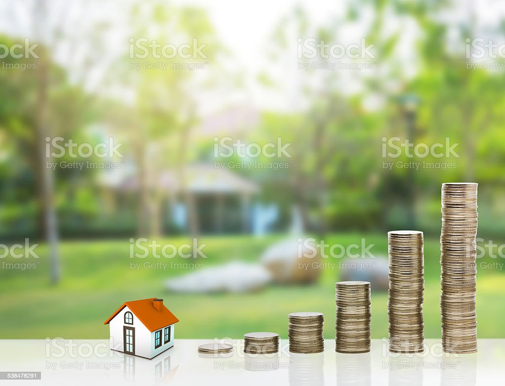 Small house and gold stack coins. stock photo