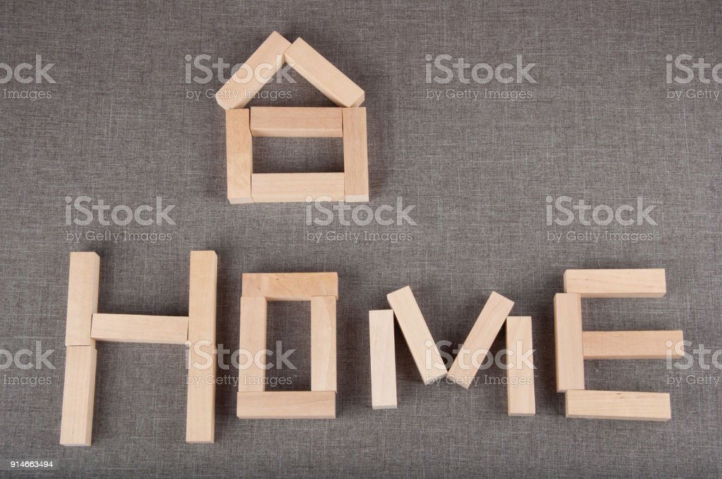 Small House Figure And Word Home Made Of Toy Wooden Bricks Lay On