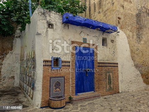 Assilah, Morocco, Africa - February 9, 2016: View of a small house with the blue door in the narrow streets of the Assilah village