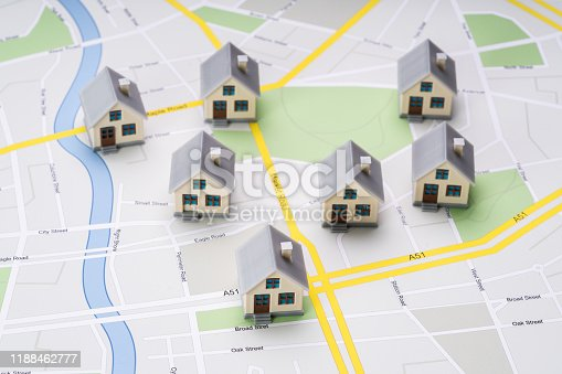 High Angle View Of Small House Models Over Road Route Map