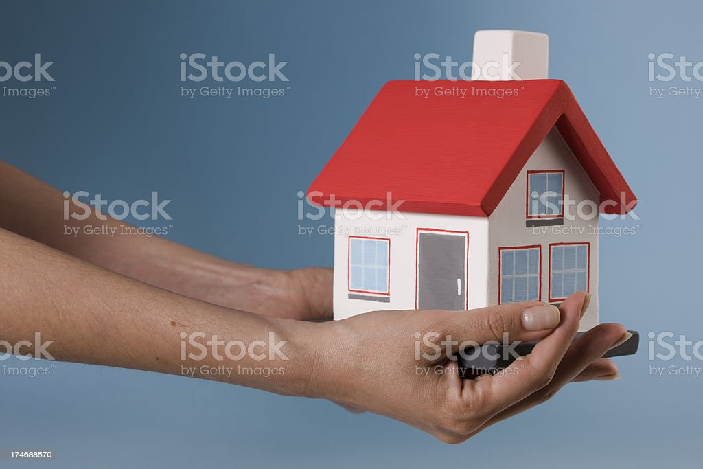 small house on a blue background royalty-free stock photo