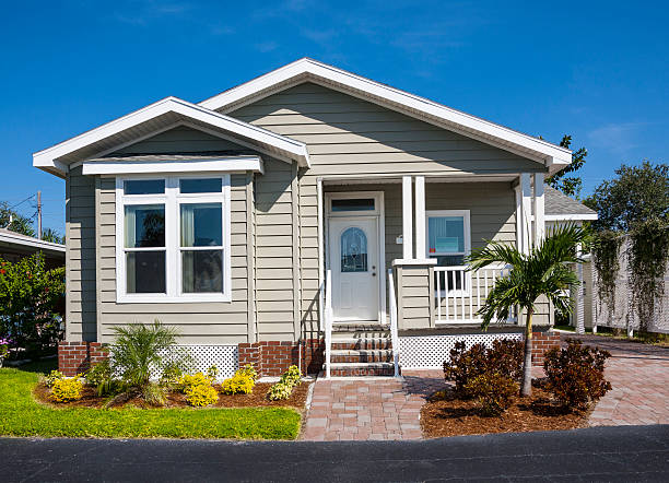Small House Small cottage; bungalow; small house. Affordable housing. bungalow stock pictures, royalty-free photos & images