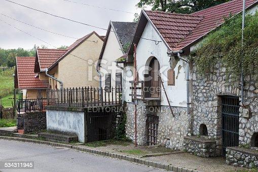 Eger, Hungary – September 15, 2014: Small house standing on the street sloped