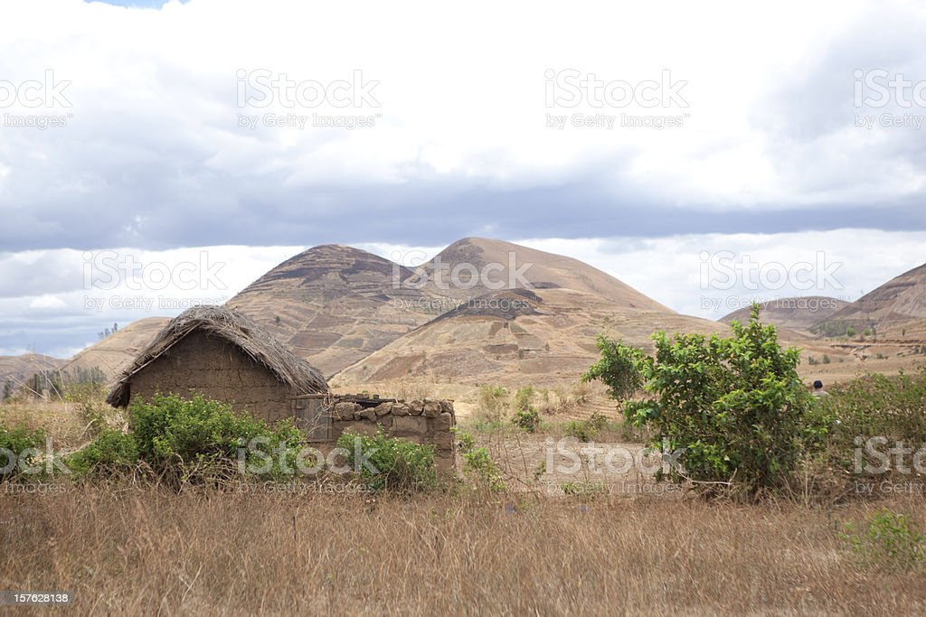 Small House with Mountains Behind, Madagascar stock photo