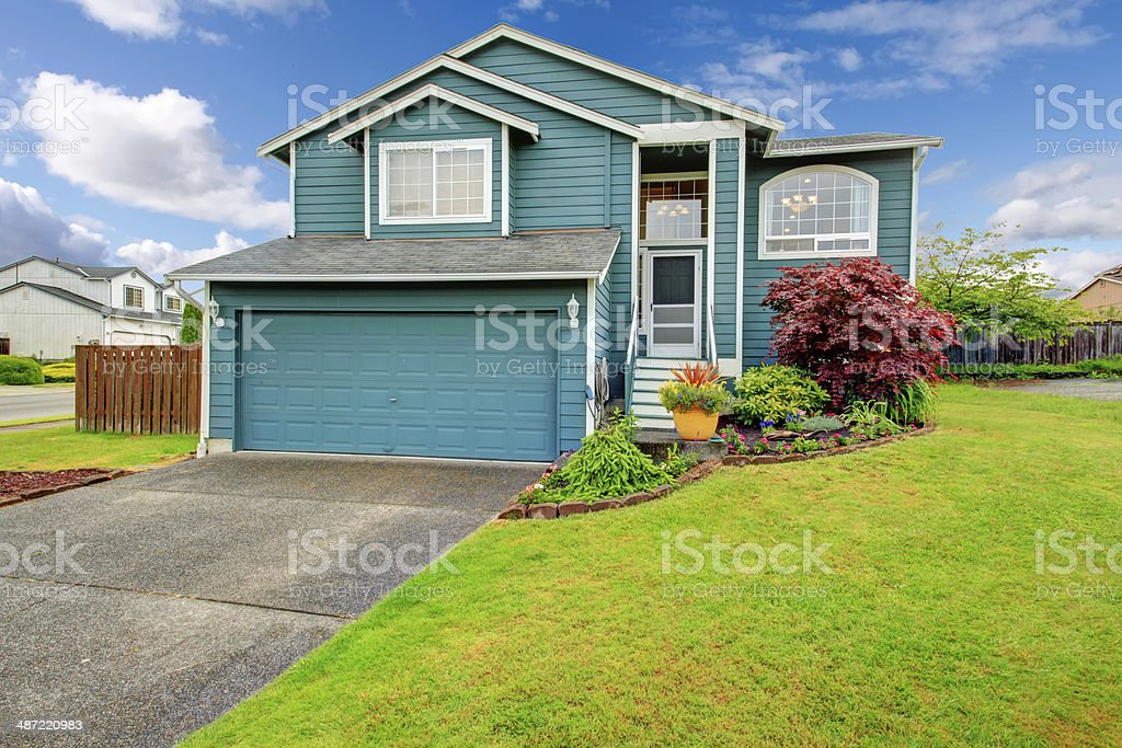 Small House With Pretty Flower Bed Stock Photo Download Image