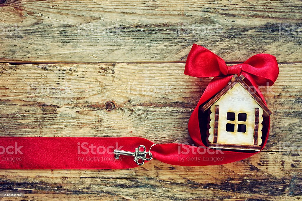small house with red ribbon and key stock photo