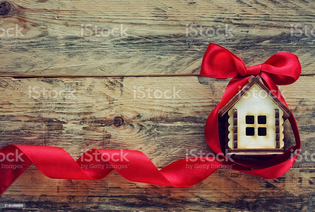 small house with red ribbon stock photo