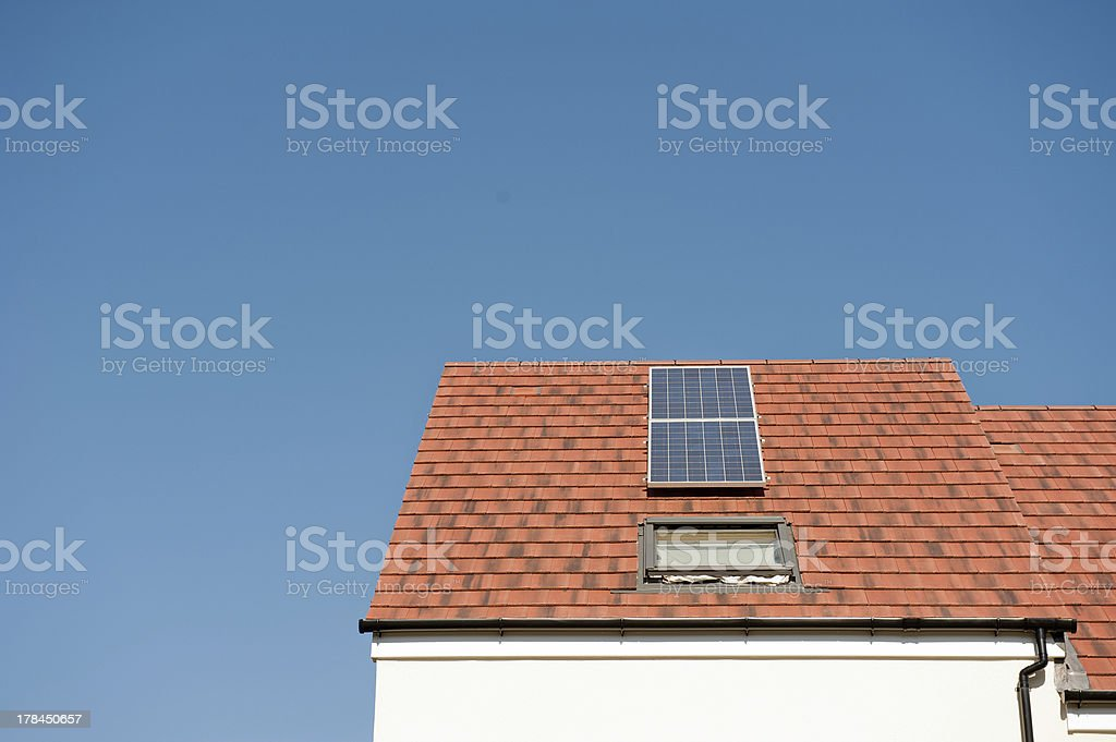 Small House With Solar Energy Panel royalty-free stock photo