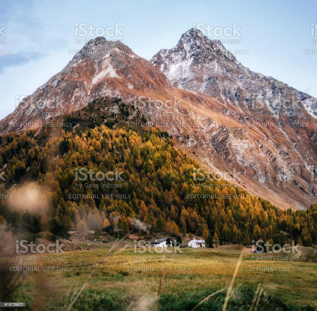 Small houses in Maloja in autumn, Switzerland. stock photo