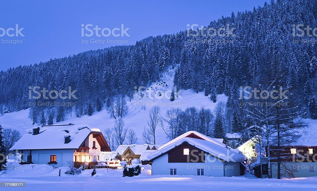 Small houses in winter wonderland stock photo