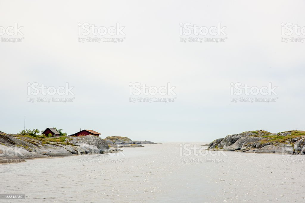 Small huts and the sea stock photo