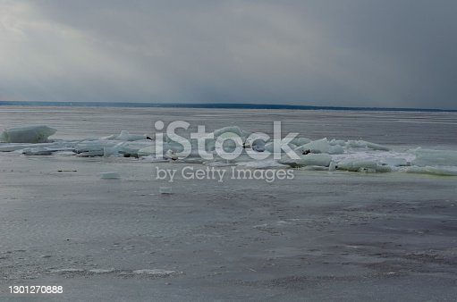 Small icebergs on the icy river