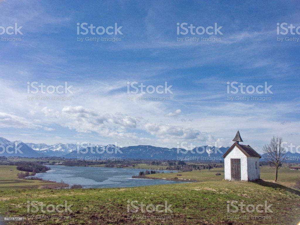 Small idyllic meadow chapel stock photo