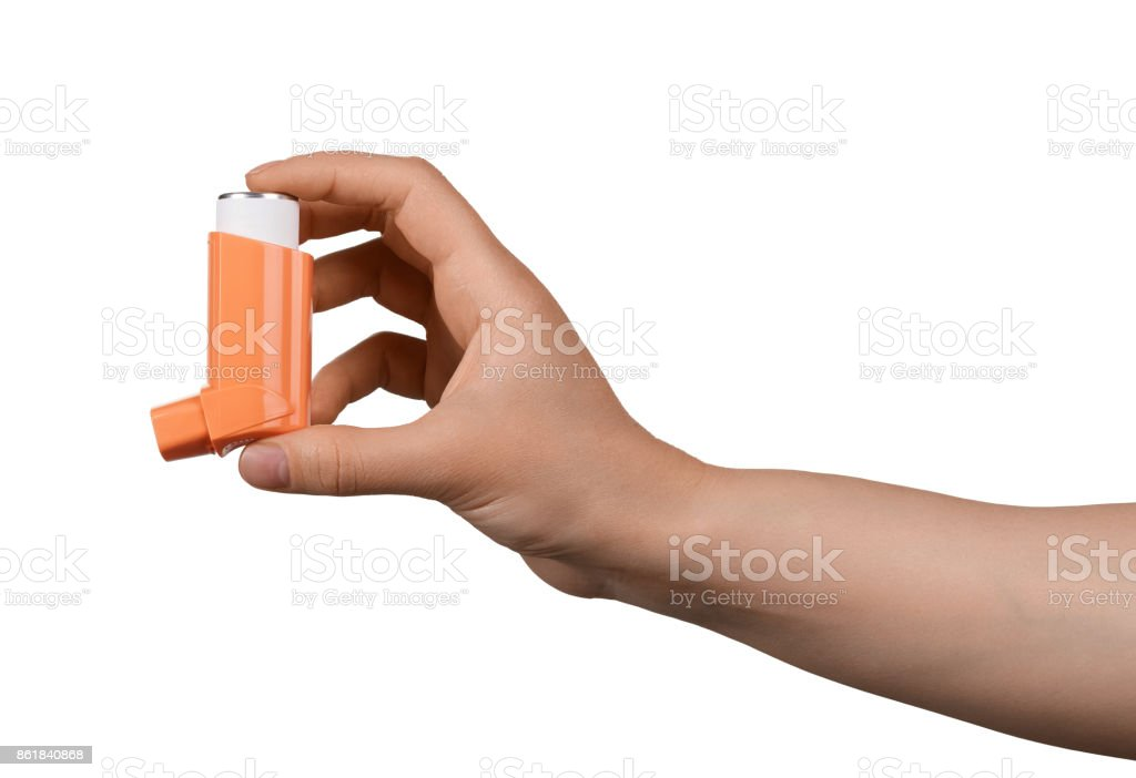 Small inhaler in a female hand, isolated on white stock photo