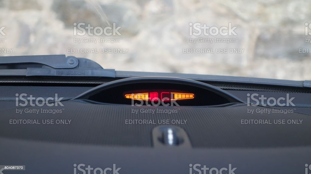 Small interior parking sensors display - distance unit measurement, yellow and red indicator, auditive beep, air vent stock photo