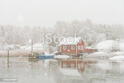 Idyllic Swedish island with red cottages.