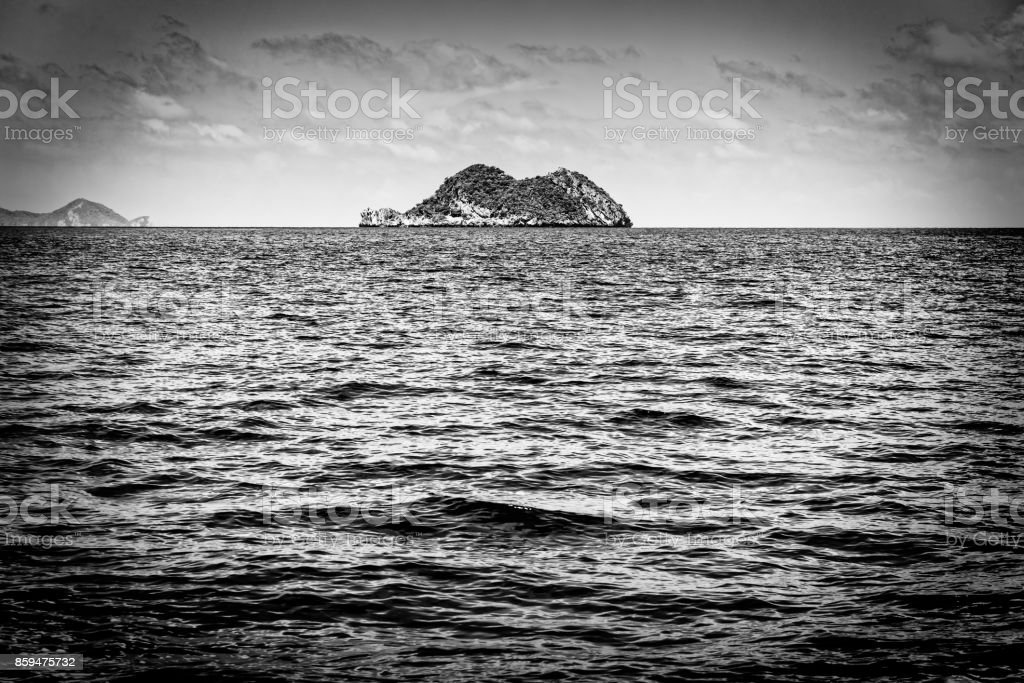 Small island in black and white stock photo