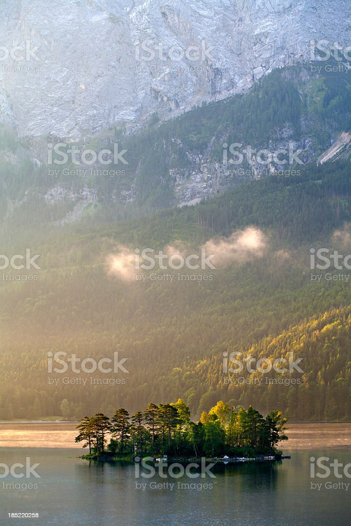 Small Island in Lake Eibsee against Mount Zugspitz at Sunrise royalty-free stock photo