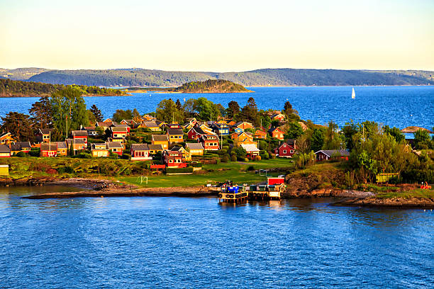 Small island with closely spaced houses, Norway Sea surroundings near Oslo, islands, Norway oslo stock pictures, royalty-free photos & images