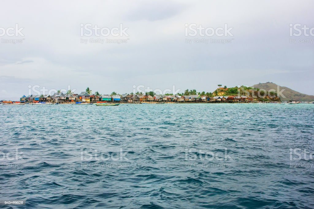 Small Island With Typical Village In Komodo National Park