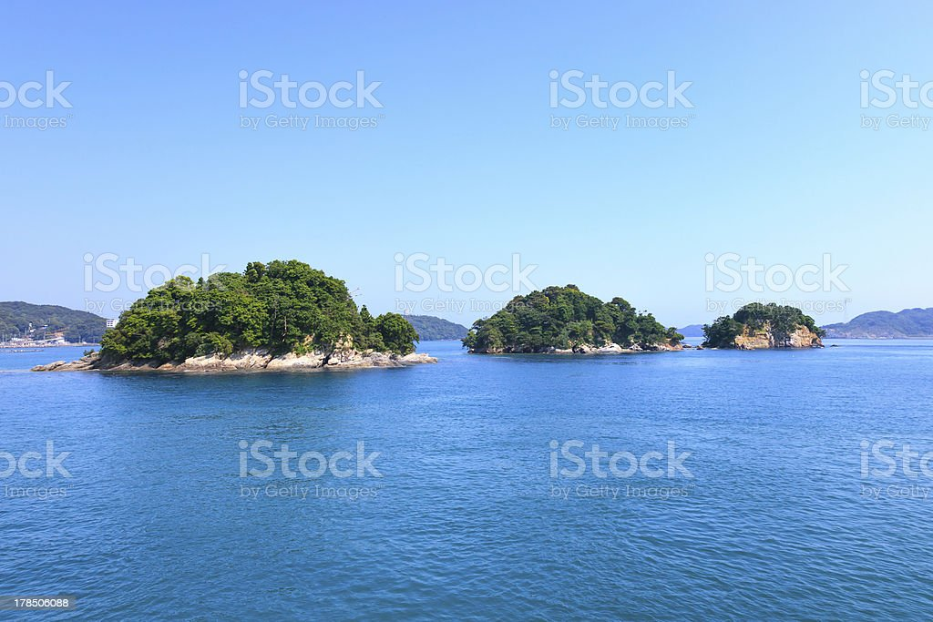 Small islands on sea and blue sky. Toba bay, Japan. stock photo