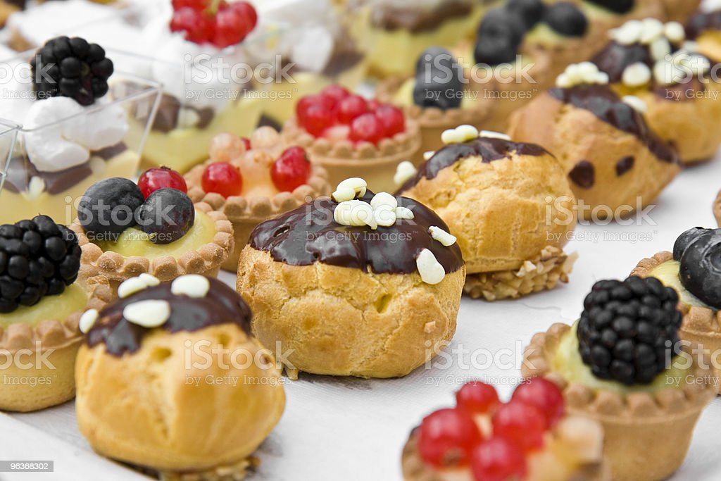 Small Italian sweet pastries with various toppings stock photo