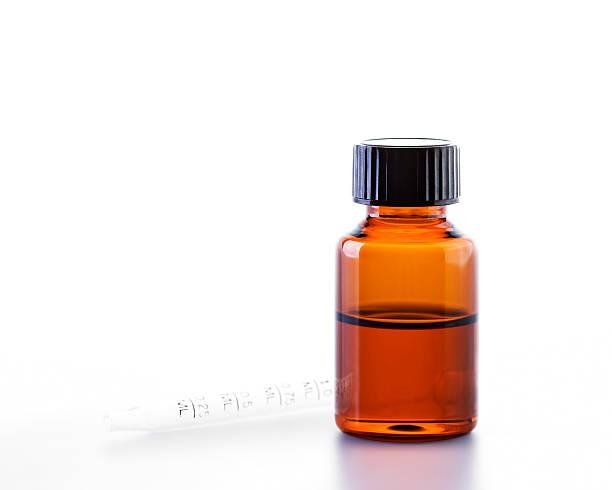 essential oil - braunglasflaschen stock-fotos und bilder