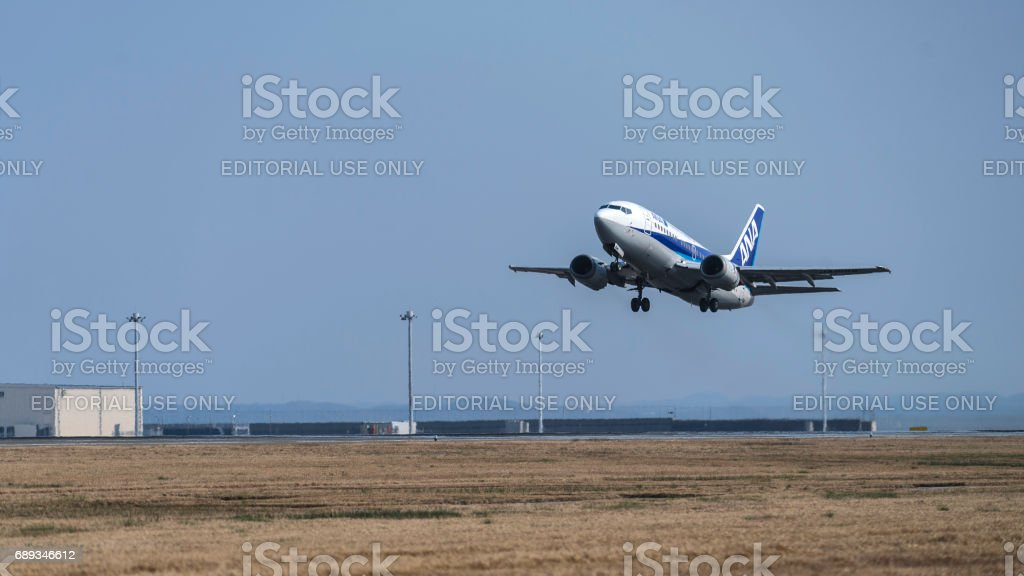 Small jet approaching to a runway stock photo